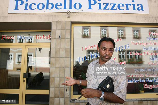 Injured Indian Kulvir Singh stands in front of a pizza shop as he talks to the press 20 August 2007 in Muegeln near Leipzig eastern Germany Singh and...