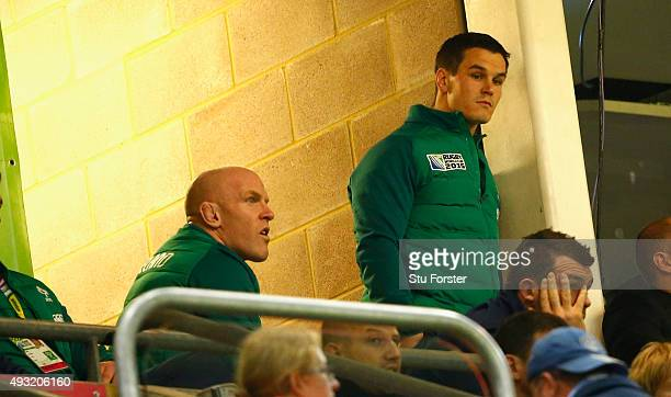 Injured Ireland captain Paul O' Connell and Jonathan Sexton look on from the stand during the 2015 Rugby World Cup Quarter Final match between...