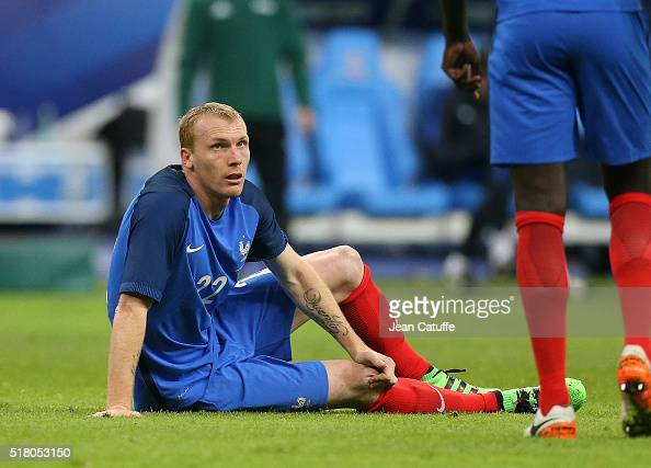 Injured Jeremy Mathieu of France looks on during the international friendly match between France and Russia at Stade de France on March 29 2016 in...
