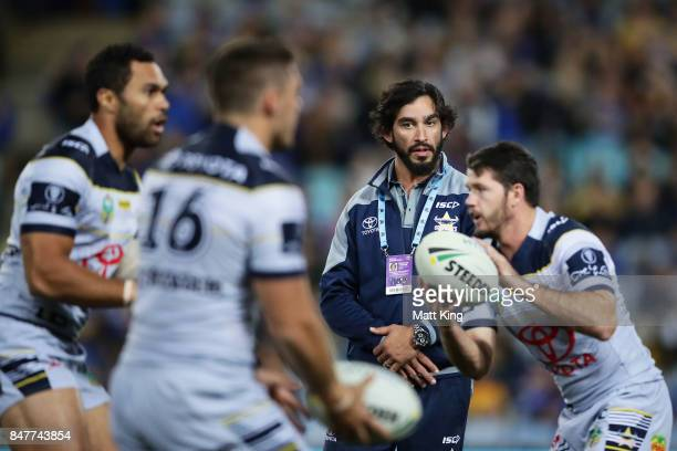 Injured Johnathan Thurston of the Cowboys looks on as the Cowboys warm up before the NRL Semi Final match between the Parramatta Eels and the North...