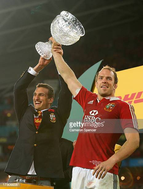 Injured Lions captain Sam Warburton and Lions captain Alun Wyn Jones hold the Tom Richards Cup aloft after the Lions victory in the International...