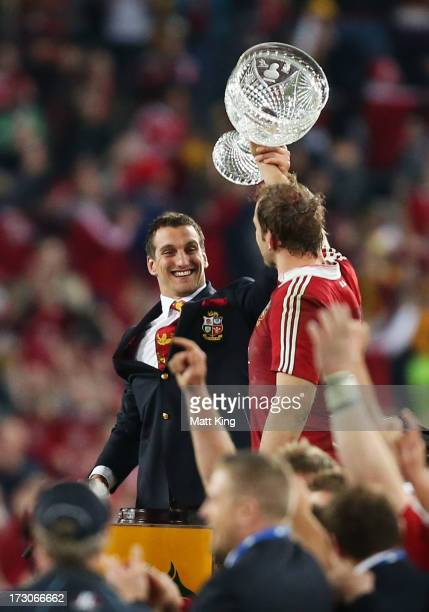 Injured Lions captain Sam Warburton and Lions captain Alun Wyn Jones hold aloft the Tom Richards Cup following victory in the International Test...