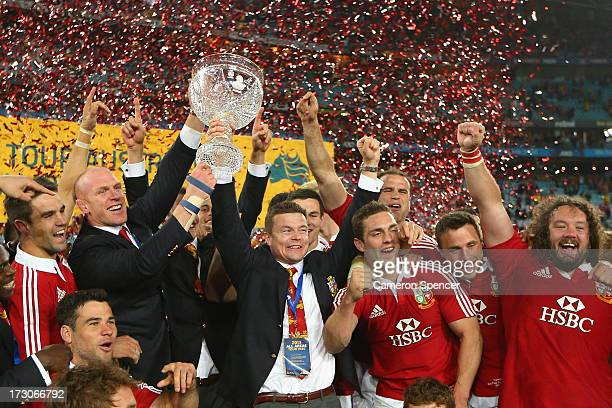 Injured Lions players Paul O'Connell and Brian O'Driscoll hold the Tom Richards Cup aloft after winning the International Test match between the...