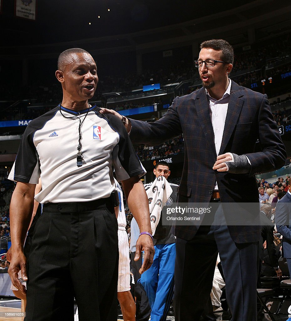 Injured Magic forward Hedo Turkoglu chats referee Michael Smith during their game against the Boston Celtics at the Amway Center on Sunday, November 25, 2012, in Orlando, Florida. The Celtics won the game 116-110.