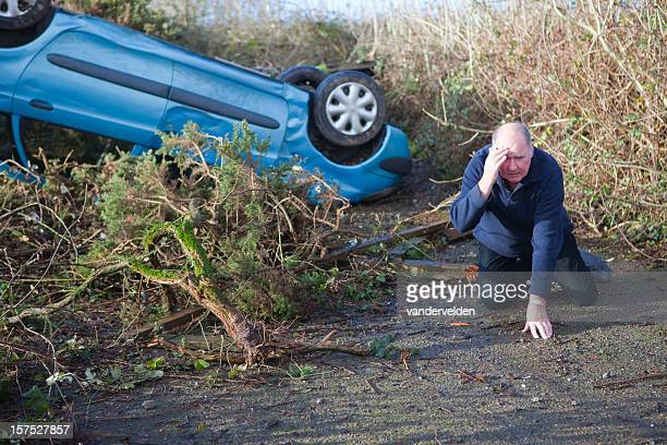 Injured man with a flipped over car