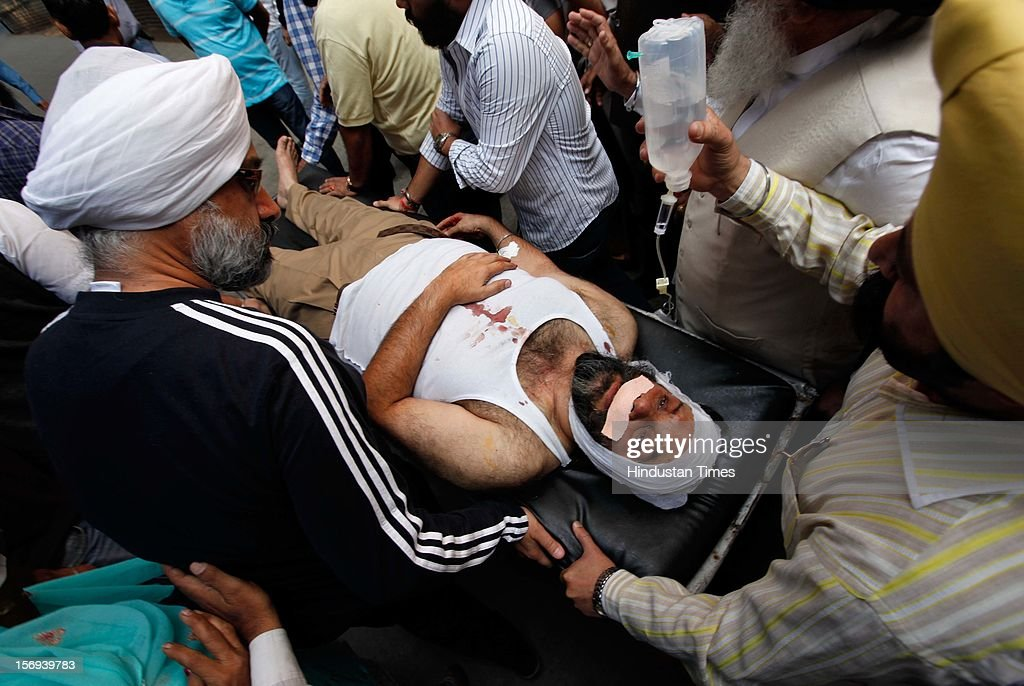 Injured Manjit Singh GK (Shiromani Akali Dal Delhi president) is carried on a stretcher as he admitted to the Ram Manohar Lohia Hospital on November 15, 2012 in New Delhi, India. After a clash between two factions Delhi Sikh Management Committee Group and Shiromani Akali Dal Delhi Group at Gurdwara Rakab Ganj in central Delhi on Thursday Morning, two people received major injuries, including Manjit Singh G.K., Shiromani Akali Dal Delhi president.