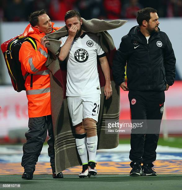 Injured Marc Stendera of Frankfurt is led off the pitch during the Bundesliga Playoff Leg 2 between 1 FC Nuernberg and Eintracht Frankfurt at...
