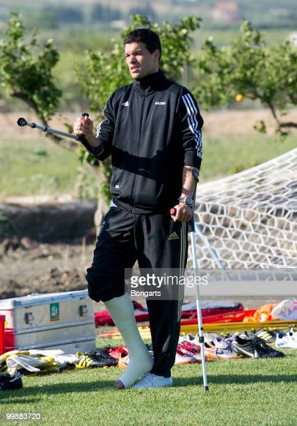 Injured Michael Ballack attends his team's training session on crutches at Verdura Golf Spa Resort on May 18 2010 in Sciacca Italy