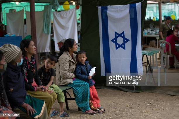 Injured Nepalese women wait to be treated by Israeli Army medic soldiers at the Israeli field hospital on the second day of their mission in...