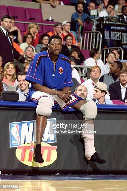 Injured New York Knicks' Patrick Ewing watches from the sidelines as clock winds down in game against the Miami Heat at Madison Square Garden