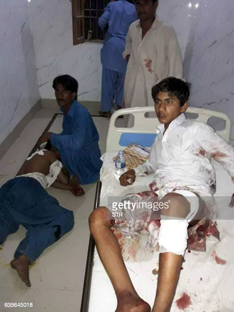 Injured Pakistani blast victims are treated at a local hospital after a bomb explosion in the shrine of 13th century Muslim Sufi saint Lal Shahbaz...