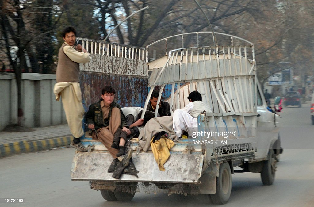 Injured Pakistani Shiite Muslims are transported to a hospital on the back of a pickup truck following a bomb blast in Quetta on February 16, 2013. A remote-controlled bomb targeting Shiite Muslims killed 47 people including women and children and wounded more than 200 in Pakistan's insurgency-hit southwest on Saturday, police and officials said. AFP PHOTO/Banaras KHAN