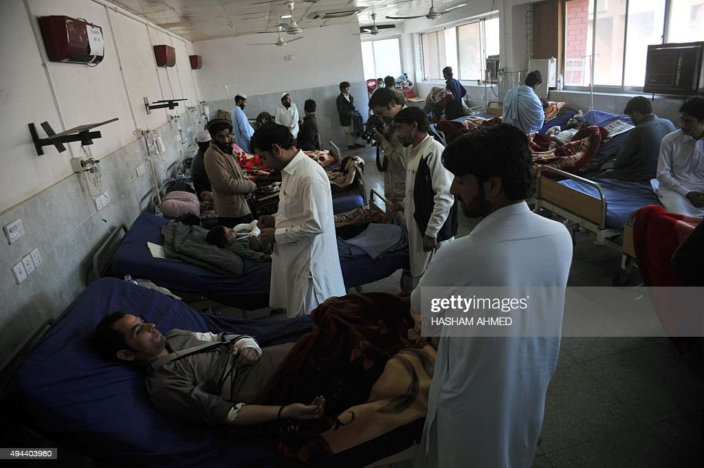Injured Pakistanis are treated in a hospital following an earthquake in Peshawar on October 27 2015 Rescuers were picking their way through rugged...