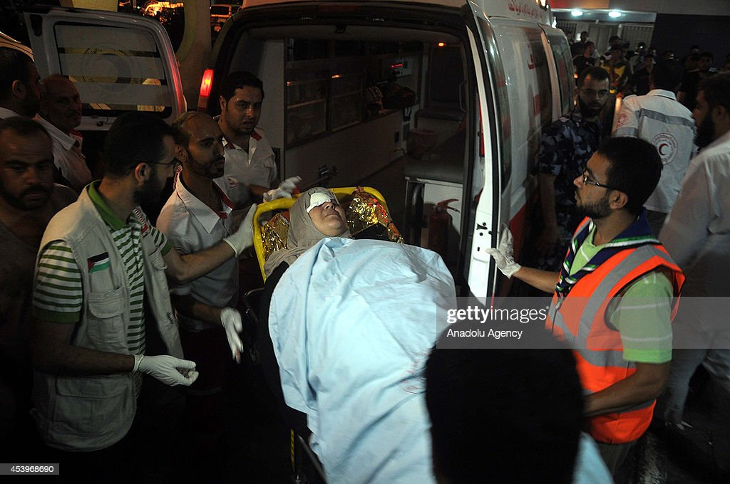 Injured Palestinians are taken to Al-Shifa Hospital after an Israeli attack, hit and destroyed Abu Aqlin family's house, in Gaza City, Gaza on August 22, 2014. Since hostilities began on July 7, at least 2091 Palestinians have been killed in the Gaza Strip the vast majority of them were civilians while more than 10,000 have been injured by devastating Israeli army's attacks. According to Israeli figures, at least 68 Israelis, four of them were civilians killed by Palestinian rocket fire, have been killed over the same period.
