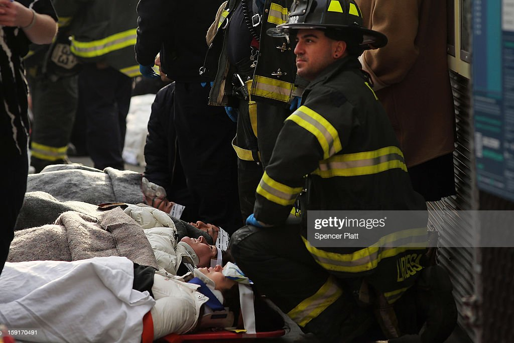 Injured passengers are aided following an early morning ferry accident during rush hour in Lower Manhattan on January 9, 2013 in New York City. About 50 people were injured in the accident, which left a large gash on the front side of the Seastreak ferry at Pier 11.