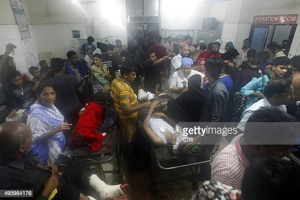 Injured people are seen in an emergency unit in Dhaka medical college hospital after a small a small bomb exploded outside Bangladesh capital's main...