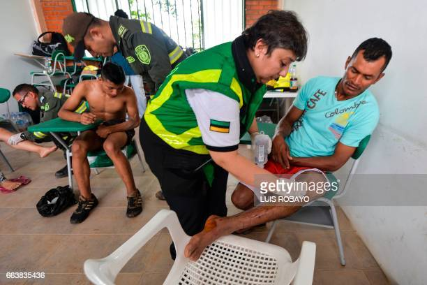 Injured people receive medical attention after mudslides following heavy rains in Mocoa Putumayo department southern Colombia on April 2 2017 The...