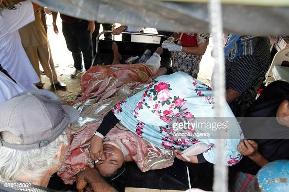 Injured people receive treatment outside a hospital in the quakedevastated area after an earthquake measuring 64 on the Richter Scale rocked Pidie...