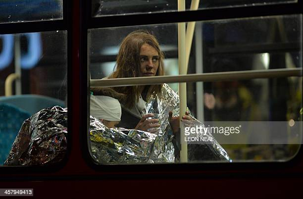 Injured people sit wrapped in emergency blankets on a London bus used for casualties follwing a ceiling collapse at a theatre in Central London on...