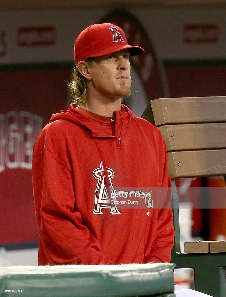 Injured pitcher Jered Weaver #36 of the Los Angeles Angels of Anaheim looks on from the dugout in the game against the Oakland Athletics at Angel Stadium of Anaheim on April 10, 2013 in Anaheim, California.