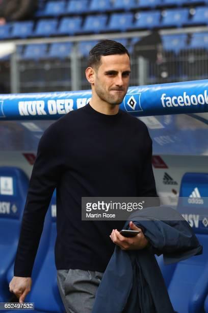 Injured player Mergim Mavraj of Hamburg looks on prior to the Bundesliga match between Hamburger SV and Borussia Moenchengladbach at Volksparkstadion...