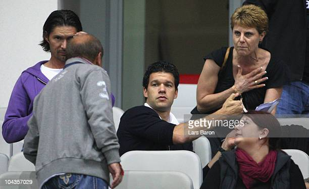 Injured player Michael Ballack of LEverkusen is seen on the tribune during the Bundesliga match between Bayer Leverkusen and Eintracht Frankfurt at...