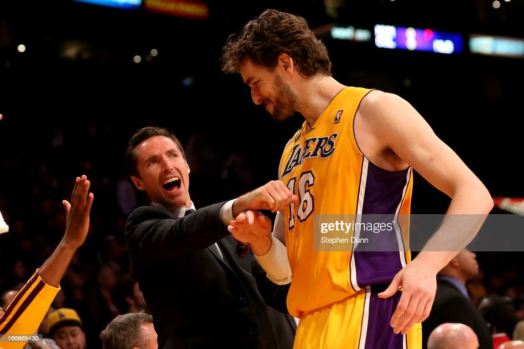 Injured player <a gi-track='captionPersonalityLinkClicked' href=/galleries/search?phrase=Steve+Nash+-+Basketball+Player&family=editorial&specificpeople=201513 ng-click='$event.stopPropagation()'>Steve Nash</a> #10 of the Los Angeles Lakers greets <a gi-track='captionPersonalityLinkClicked' href=/galleries/search?phrase=Pau+Gasol&family=editorial&specificpeople=201587 ng-click='$event.stopPropagation()'>Pau Gasol</a> #16 as he comes off the floor in the colsing seconds of the game against the Houston Rockets at Staples Center on April 17, 2013 in Los Angeles, California. The Lakers won 99-95 in overtime.