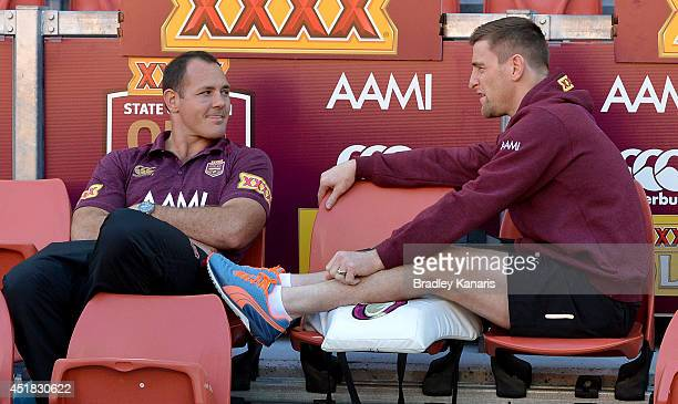 Injured players Matt Scott and Brent Tate watch on from the sideline during a Queensland Maroons State of Origin captain's run at Suncorp Stadium on...
