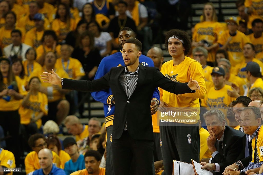 Injured point guard <a gi-track='captionPersonalityLinkClicked' href=/galleries/search?phrase=Stephen+Curry+-+Basketball+Player&family=editorial&specificpeople=5040623 ng-click='$event.stopPropagation()'>Stephen Curry</a> #30 of the Golden State Warriors supports his team from the bench in Game Two of the Western Conference Quarterfinals during the 2016 NBA Playoffs at ORACLE Arena on April 18, 2016 in Oakland, California.