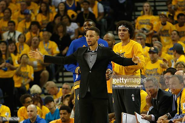 Injured point guard Stephen Curry of the Golden State Warriors supports his team from the bench in Game Two of the Western Conference Quarterfinals...