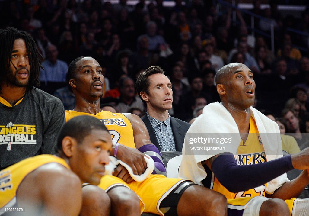 Injured point guard Steve Nash of the Los Angeles Lakers follows the game from the bench with his teammates from left Metta World Peace Jordan Hill...