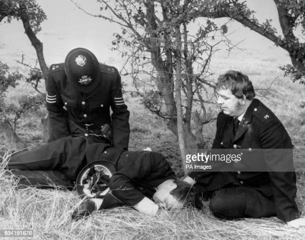 Injured policeman is cared for by colleagues after a bombardment by pickets at the Gascoigne Wood drift mine at Selby