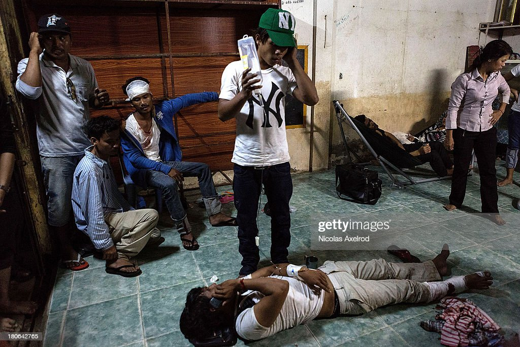 Injured protestors in a make shift clinic after clashes erupted near Monivong bridge South of Phnom Penh on September 15, 2013 in Phnom Penh, Cambodia. The CNRP plan a three day demonstration to contest the Cambodian national election results.