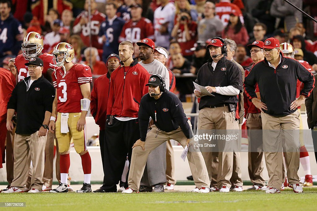 Injured quarterback Alex Smith #11 and head coach Jim Harbaugh of the San Francisco 49ers look on from the sidelines in the third quarter against the Chicago Bears at Candlestick Park on November 19, 2012 in San Francisco, California.