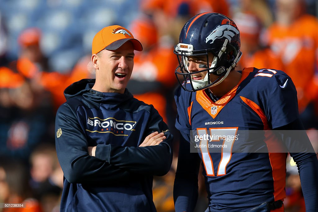 Injured quarterback <a gi-track='captionPersonalityLinkClicked' href=/galleries/search?phrase=Peyton+Manning&family=editorial&specificpeople=184524 ng-click='$event.stopPropagation()'>Peyton Manning</a> of the Denver Broncos, left, has a word with quarterback <a gi-track='captionPersonalityLinkClicked' href=/galleries/search?phrase=Brock+Osweiler&family=editorial&specificpeople=6501030 ng-click='$event.stopPropagation()'>Brock Osweiler</a> #17 as players warm up before a game against the Oakland Raiders at Sports Authority Field at Mile High on December 13, 2015 in Denver, Colorado.