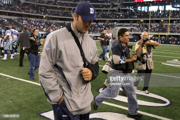 Injured quarterback Tony Romo of the Dallas Cowboys walks off the field with his head down after the Cowboys lost 3517 against the Jacksonville...