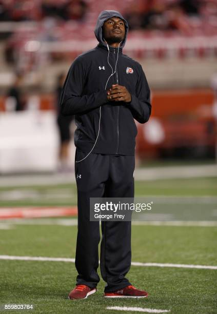 Injured quarterback Tyler Huntley of the Utah Utes watches warmups before an college football game against the Stanford Cardinal on October 7 2017 at...