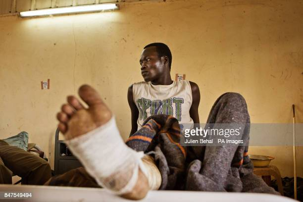 Injured refugees and soldiers in the joint SSudan/Goal administered clinic in BunjMaban in the Upper Nile Blue Nile region of northeastern South...