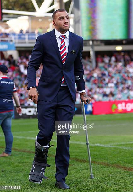 Injured Roosters centre Blake Ferguson watches from the sideline during the round eight NRL match between the Sydney Roosters and the St George...