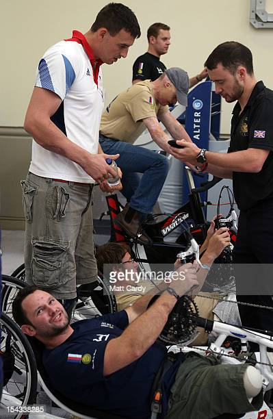 Injured servicemen chat as they use some of the exercise machines in the new Help for Heroes' Tedworth House rehabilitation centre for wounded...