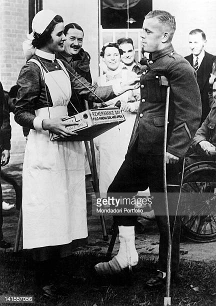Injured soldier receiving a flower in a hospital on the Remembrance Day London 11th November 1939