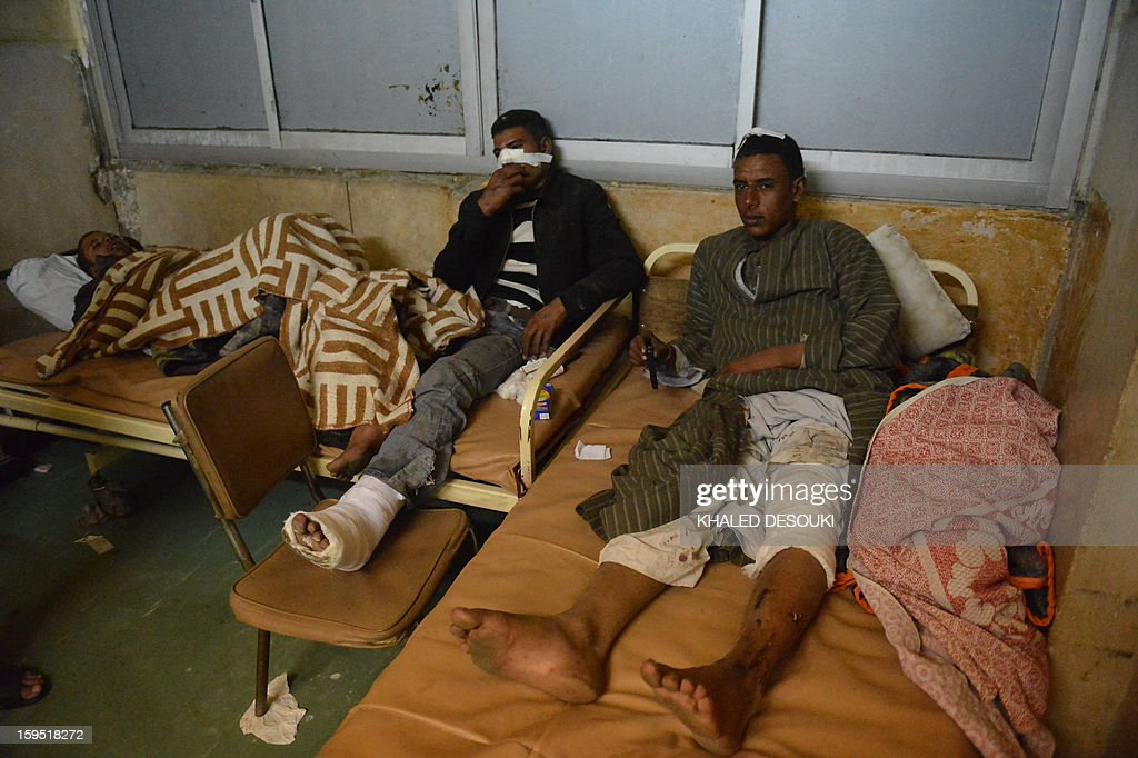 Injured soldiers lie on beds at a hospital after a train carrying conscripts derailed in the Giza neighbourhood of Badrasheen, about 40 kilometres south of Cairo, on January 15, 2013, killing 19 people and wounding 107. The accident is the latest in a string of transport disasters plaguing Egypt, and comes just two weeks after a new transport minister, Hatem Abdul Latif was appointed. AFP PHOTO / KHALED DESOUKI