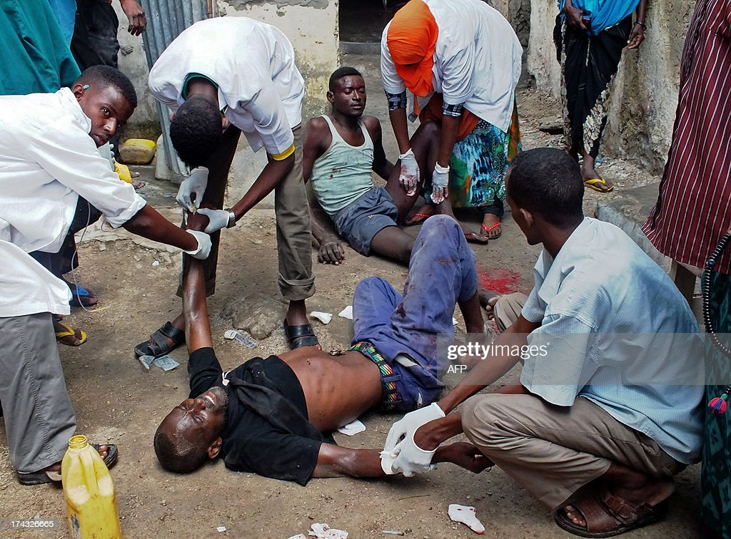 Injured Somalis are given medical care after a bomb blast targeted at a Somali MP took place at Hamarweyne Market in Mogadishu on July 24, 2013. At least one civilian died and several were injured in the blast.