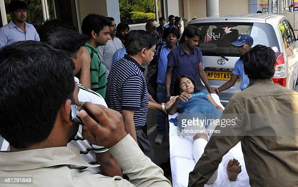 Injured students of IIMIndore are being taken out on a stretcher as a wooden structure prepared for taking group photographs of graduating batch...
