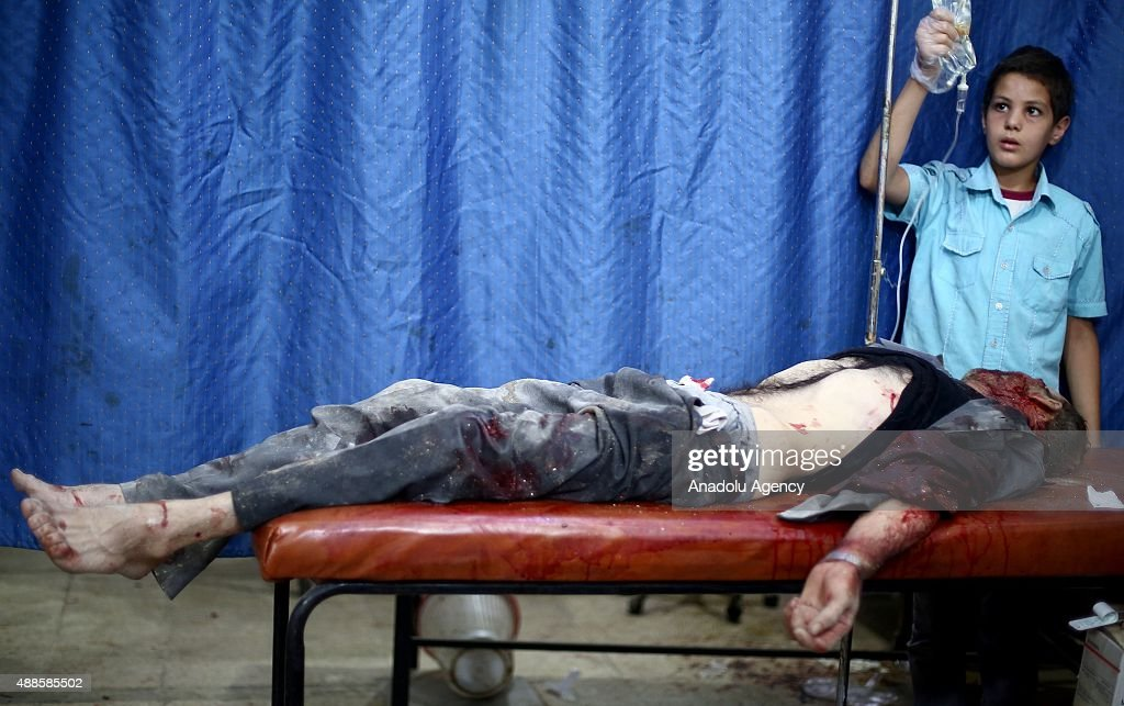 A Injured Syrian man receives treatment at a field hospital after Assad regime forces' air attacks on an opposition controlled residential area in Douma town, in the eastern Gouta region of Damascus, Syria on September 16, 2015.