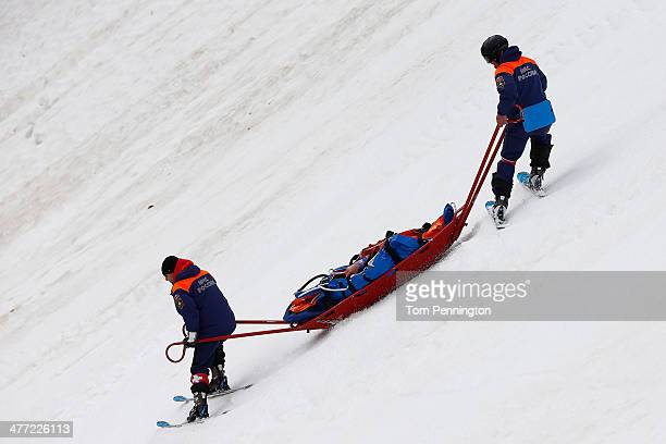 Injured Tyler Walker of United States is stretchered off the mountain after crashing in the Men's Downhill Sitting during day one of Sochi 2014...