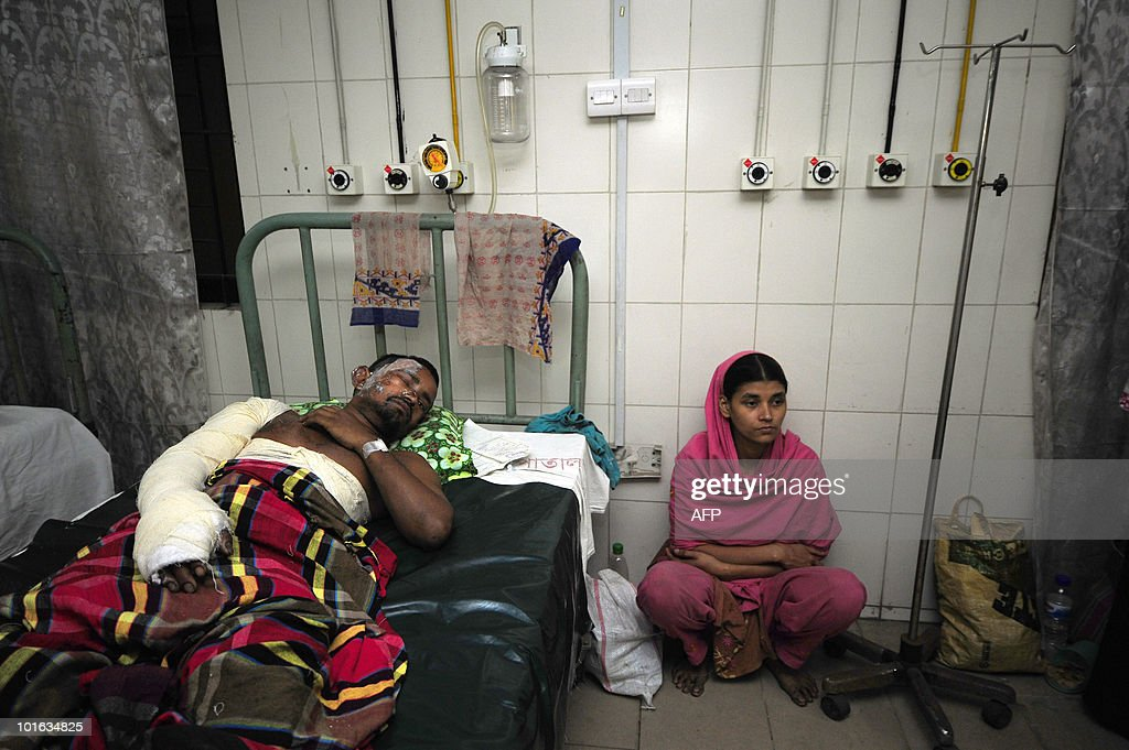 Injured victims of the Old Dhaka fire wait inside the Medical Hospital in Dhaka on June 5 , 2010. The national flag flew at half-mast and people of all faiths joined prayers as Bangladesh mourned the deaths of nearly 120 people in the country's deadliest blaze.