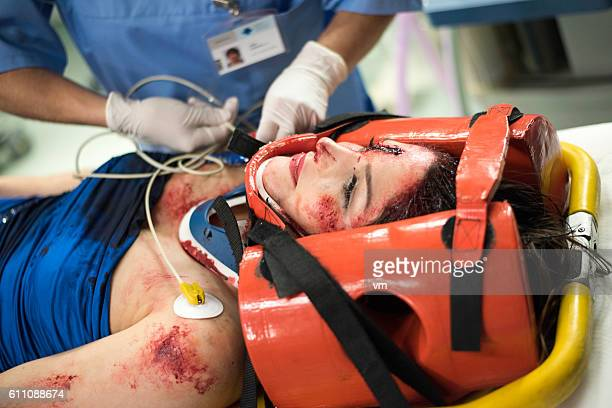 Injured woman with a head brace lying down