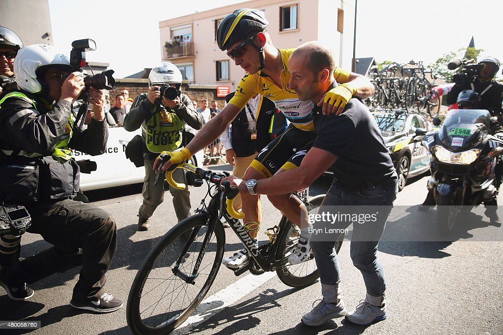 Injured yellow jersey wearer <a gi-track='captionPersonalityLinkClicked' href=/galleries/search?phrase=Tony+Martin+-+Cyclist&family=editorial&specificpeople=5399396 ng-click='$event.stopPropagation()'>Tony Martin</a> of Germany and Etixx-Quick Step is given assistance after a fall close to the finish during stage six of the 2015 Tour de France, a 191.5km stage between Abbeville and Le Havre, on July 9, 2015 in Le Havre, France.
