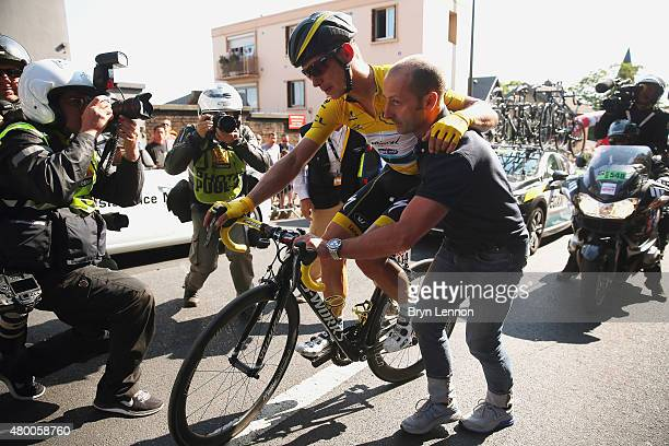 Injured yellow jersey wearer Tony Martin of Germany and EtixxQuick Step is given assistance after a fall close to the finish during stage six of the...
